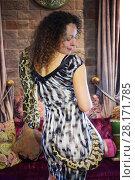 Купить «Beautiful woman poses with big snake near couch in room, back view, focus on snake», фото № 28171785, снято 18 июля 2016 г. (c) Losevsky Pavel / Фотобанк Лори