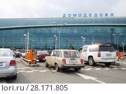 Купить «MOSCOW - JUL 20, 2016: Parking in Domodedovo airport, Airport route network covers more than 189 destination», фото № 28171805, снято 20 июля 2016 г. (c) Losevsky Pavel / Фотобанк Лори