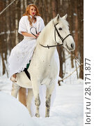 Купить «Young woman in white dress and white fur mantle on white horse in park», фото № 28171877, снято 15 января 2016 г. (c) Losevsky Pavel / Фотобанк Лори