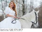 Купить «Young woman in white dress rides on white horse in park», фото № 28171917, снято 15 января 2016 г. (c) Losevsky Pavel / Фотобанк Лори