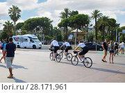 Купить «NICE, FRANCE - JUL 24, 2016: Police on bicycles, After terrorist attack July 14, 2016 in Nice to reinforce patrolling tourist places», фото № 28171961, снято 24 июля 2016 г. (c) Losevsky Pavel / Фотобанк Лори