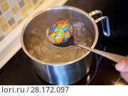 Купить «MOSCOW - APR 30, 2016: Hand gets out of boiling water egg with cover with print in kitchen. There is tradition to put pictures on eggs in Orthodox Easter in Russia», фото № 28172097, снято 30 апреля 2016 г. (c) Losevsky Pavel / Фотобанк Лори