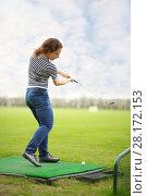 Купить «Woman with cammock plays golf on green golf course at summer», фото № 28172153, снято 1 мая 2016 г. (c) Losevsky Pavel / Фотобанк Лори