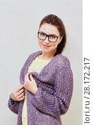 Купить «Half-length portrait of smiling girl in yellow dress and violet knitted cardigan», фото № 28172217, снято 19 января 2016 г. (c) Losevsky Pavel / Фотобанк Лори