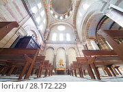 Купить «MARSEILLE, FRANCE - JUL 30, 2016: Interior of sunny Marseille cathedral with wooden benches», фото № 28172229, снято 30 июля 2016 г. (c) Losevsky Pavel / Фотобанк Лори