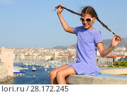 Купить «Girl with funny braids sits on concrete on hill with views of old port Marseille, France», фото № 28172245, снято 30 июля 2016 г. (c) Losevsky Pavel / Фотобанк Лори