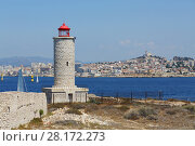 Купить «Lighthouse on IF island and yachts sail near coastal city with Notre-Dame De La Garde cathedral in Marseille, France», фото № 28172273, снято 31 июля 2016 г. (c) Losevsky Pavel / Фотобанк Лори