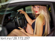 Купить «Young woman sits on driver seat of modern white car at underground parking», фото № 28172297, снято 2 июня 2016 г. (c) Losevsky Pavel / Фотобанк Лори
