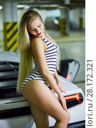 Купить «Young blonde woman in striped bodysuit poses at modern white car trunk at underground parking», фото № 28172321, снято 2 июня 2016 г. (c) Losevsky Pavel / Фотобанк Лори