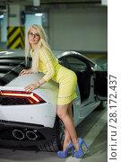 Купить «Slim blonde woman in yellow dress stands leaning on trunk of modern white car at underground parking», фото № 28172437, снято 2 июня 2016 г. (c) Losevsky Pavel / Фотобанк Лори