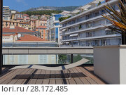 Купить «Sunbed and place to relax on terrace of one of modern buildings of Monte Carlo», фото № 28172485, снято 3 августа 2016 г. (c) Losevsky Pavel / Фотобанк Лори