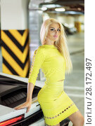 Купить «Young smiling woman in yellow dress stands leaning back onto trunk of modern white car at underground parking», фото № 28172497, снято 2 июня 2016 г. (c) Losevsky Pavel / Фотобанк Лори