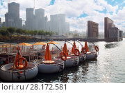 Купить «Rows of circle promenade motor boat at rest with man in one and construction buildings aback in Seoul», фото № 28172581, снято 3 ноября 2015 г. (c) Losevsky Pavel / Фотобанк Лори