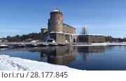 Купить «Старинная крепость города Савонлинна солнечным мартовским днем. Финляндия», видеоролик № 28177845, снято 3 марта 2018 г. (c) Виктор Карасев / Фотобанк Лори