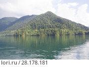 Купить «Beautiful mountain lake Ritsa in Abkhazia. View of the lake from the Stalin cottage», фото № 28178181, снято 12 августа 2014 г. (c) Олег Хархан / Фотобанк Лори