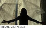 Купить «Woman throw out curtains», видеоролик № 28178393, снято 20 февраля 2018 г. (c) Илья Шаматура / Фотобанк Лори