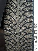 Купить «Worn dirty tread of winter studded car tire», фото № 28178937, снято 13 марта 2018 г. (c) Евгений Харитонов / Фотобанк Лори