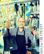 Купить «seller smiling at gardening section», фото № 28179517, снято 18 ноября 2018 г. (c) Яков Филимонов / Фотобанк Лори