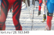 KAZAN, RUSSIA - March, 2018: slow motion professional ski marathon, focus on the feet and skis athletes and ski track, the snow flying from under the skis. Редакционное видео, видеограф Константин Шишкин / Фотобанк Лори