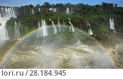 Купить «Cataratas del Iguazu Waterfall on Iguazu River in National Park, Parana, Brazil», видеоролик № 28184945, снято 22 марта 2017 г. (c) Яков Филимонов / Фотобанк Лори