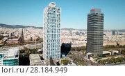 Купить «Aerial view of Barcelona cityscape with skyscrapers on Mediterranean coast», видеоролик № 28184949, снято 16 января 2018 г. (c) Яков Филимонов / Фотобанк Лори