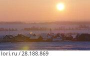 Купить «Sunrise over frozen snow-covered russian rustic landscape, telephoto», видеоролик № 28188869, снято 20 августа 2019 г. (c) Константин Шишкин / Фотобанк Лори