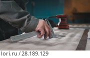 Купить «Worker making measurements and marks on the metal part using a caliper», фото № 28189129, снято 21 мая 2018 г. (c) Константин Шишкин / Фотобанк Лори