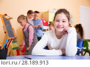 Купить «Smiling schoolgirl in classroom during break», фото № 28189913, снято 28 января 2018 г. (c) Яков Филимонов / Фотобанк Лори