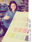 Купить «smiling female customer examining color scheme variants in paint store», фото № 28190197, снято 9 марта 2017 г. (c) Яков Филимонов / Фотобанк Лори