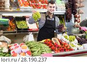 Купить «Male shopping assistant weighing grapes in grocery shop», фото № 28190237, снято 18 марта 2017 г. (c) Яков Филимонов / Фотобанк Лори