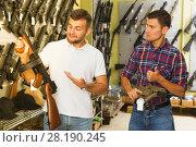 Купить «Men choosing air weapon», фото № 28190245, снято 4 июля 2017 г. (c) Яков Филимонов / Фотобанк Лори