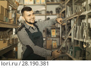 Male worker demonstrates a secateur. Стоковое фото, фотограф Яков Филимонов / Фотобанк Лори
