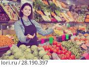 Купить «Female shopping assistant demonstrating assortment of grocery shop», фото № 28190397, снято 18 марта 2017 г. (c) Яков Филимонов / Фотобанк Лори
