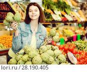 Купить «Woman choosing fruit», фото № 28190405, снято 18 марта 2017 г. (c) Яков Филимонов / Фотобанк Лори
