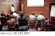 Купить «Public speaker giving talk at business event», видеоролик № 28191057, снято 5 апреля 2020 г. (c) Matej Kastelic / Фотобанк Лори
