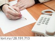 Купить «Девушка пишет ручкой на листе бумаги, крупный план», фото № 28191713, снято 8 марта 2011 г. (c) Кекяляйнен Андрей / Фотобанк Лори