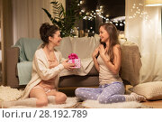 Купить «happy female friends with christmas gift at home», фото № 28192789, снято 21 января 2018 г. (c) Syda Productions / Фотобанк Лори