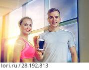 Купить «smiling young woman with personal trainer in gym», фото № 28192813, снято 29 июня 2014 г. (c) Syda Productions / Фотобанк Лори