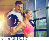 Купить «smiling man and woman with barbell in gym», фото № 28192817, снято 29 июня 2014 г. (c) Syda Productions / Фотобанк Лори