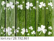 Купить «shamrock pattern on old green wooden boards», фото № 28192861, снято 30 сентября 2015 г. (c) Syda Productions / Фотобанк Лори