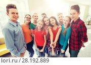 Купить «group of students taking selfie with smartphone», фото № 28192889, снято 22 апреля 2016 г. (c) Syda Productions / Фотобанк Лори