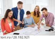 creative team with blueprint working at office. Стоковое фото, фотограф Syda Productions / Фотобанк Лори