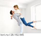 Купить «happy couple at empty room of new home», фото № 28192945, снято 4 июня 2017 г. (c) Syda Productions / Фотобанк Лори