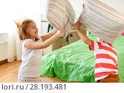 Купить «kids playing and fighting by pillows at home», фото № 28193481, снято 15 октября 2017 г. (c) Syda Productions / Фотобанк Лори
