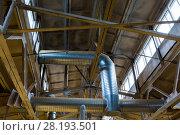 Купить «ventilation pipes at factory shop», фото № 28193501, снято 10 ноября 2017 г. (c) Syda Productions / Фотобанк Лори