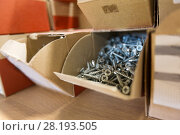 Купить «screws in cardboard boxes at workshop», фото № 28193505, снято 10 ноября 2017 г. (c) Syda Productions / Фотобанк Лори