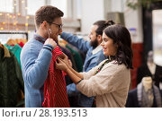 Купить «couple choosing clothes at vintage clothing store», фото № 28193513, снято 30 ноября 2017 г. (c) Syda Productions / Фотобанк Лори