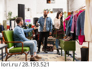 Купить «friends choosing clothes at vintage clothing store», фото № 28193521, снято 30 ноября 2017 г. (c) Syda Productions / Фотобанк Лори