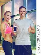 Купить «smiling young woman with personal trainer in gym», фото № 28193613, снято 29 июня 2014 г. (c) Syda Productions / Фотобанк Лори