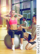 Купить «smiling man and woman with exercise ball in gym», фото № 28193621, снято 29 июня 2014 г. (c) Syda Productions / Фотобанк Лори